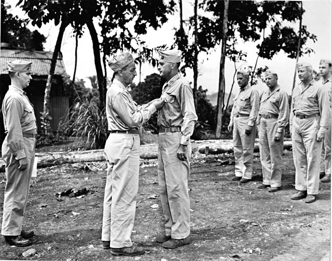 Maj. Gen. Ralph Mitchell (left), commander of 1st Marine Aircraft Wing, awards the Legion of Merit to Colonel Clayton Jerome, May 1944. Jerome later served as C.O. of MAG-32.