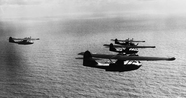 "A ""Black Cat"" squadron on patrol in the Southwest Pacific, May 1944. Besides scouting duties, the versatile PBYs also engaged in bombing, strafing, and rescue missions."
