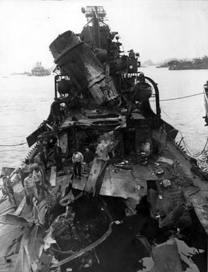 The Fletcher-class destroyer USS Newcomb was struck by five Kamikazes during a 90-minute ordeal off Okinawa. This photograph reveals the extent of the damage the ship sustained. Remarkably, the destroyer remained afloat despite the destruction.