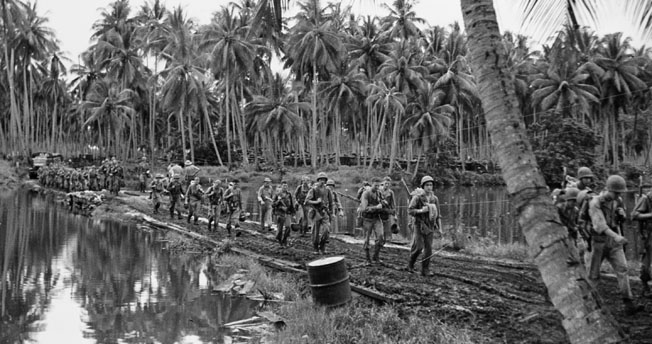 U.S. Army troops advance on January 30 as part of the operation to outflank the Japanese on Guadalcanal.