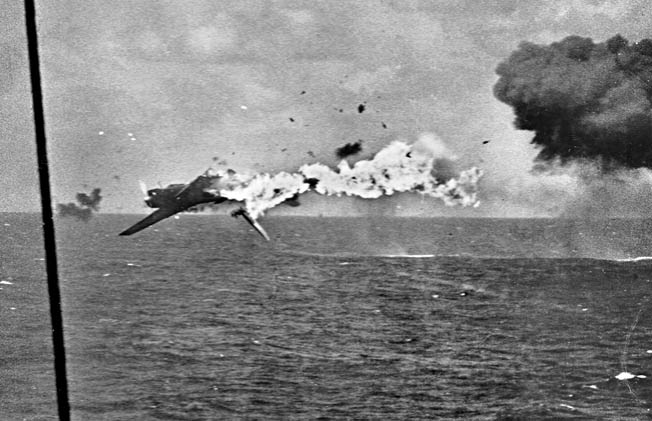 "A Japanese ""Kate"" torpedo bomber takes a direct hit from a 5-inch gun during the same engagement."