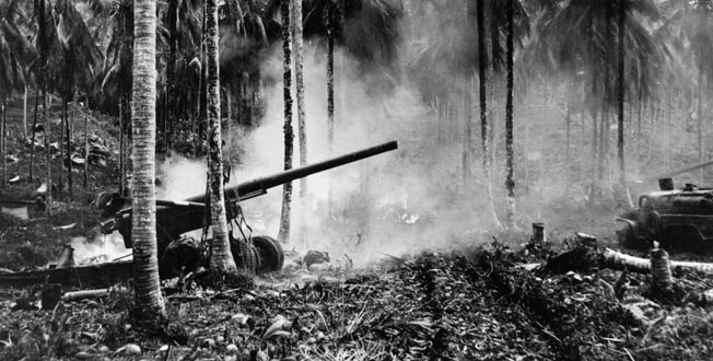 """The Japanese staged air raids to counter the American invasion. Here, smoke from an exploding Japanese bomb drifts over a U.S. Army 155mm """"Long Tom"""" gun on Rendova that was bombarding enemy positions on New Georgia."""