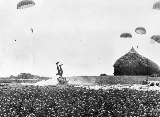 An American paratrooper tumbles upon landing in a Dutch field during the airborne phase of Operation Market Garden, September 17, 1944.