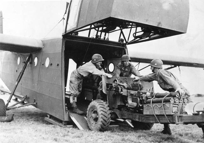 American airborne soldiers wrestle a 57mm gun aboard one of more than 1,000 gliders used by British and American airborne units during Operation Market Garden.