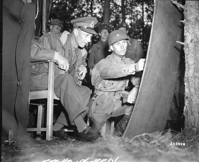 Brigadier General James Gavin, commander of the 82nd Airborne Division, confers with General Miles Dempsey, commander of the British Second Army, several days into the Market Garden operation.