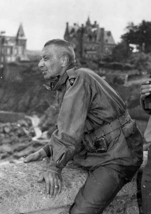 Major General Robert Macon, commander of the U.S. 83rd Infantry Division, watches the effect of Allied artillery fire on the island of Cezembre, near St. Malo, France.