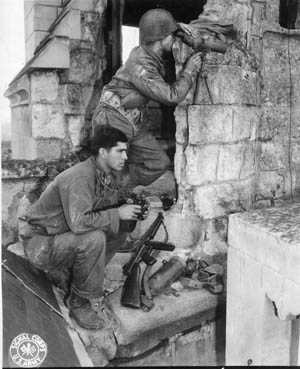 Soldiers of the 83rd Infantry Division occupy an observation post in France during the summer of 1944. Following the breakout from the hedgerow country of Normandy, that summer was one of tremendous gains and rapid movement.