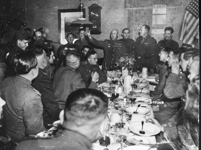 At Cobbelsdorf, Germany, near the Elbe River, officers of the 83rd Infantry Division are entertained by their Soviet Red Army hosts during a victor's banquet in May 1945. According to terms agreed upon by Allied leaders, American soldiers halted their eastward advance into Germany when they reached the Elbe.