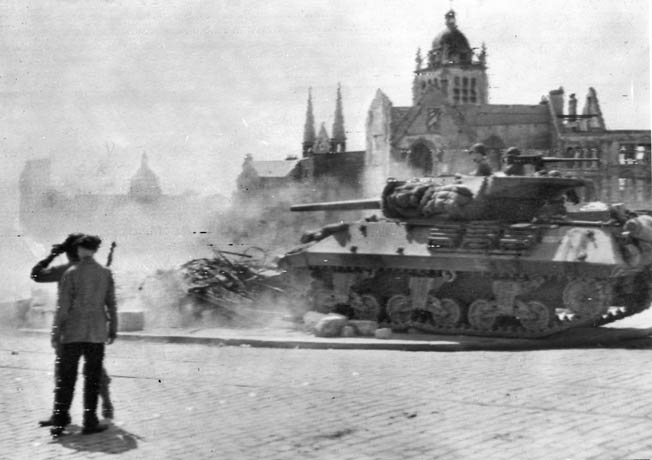 An open-turreted American tank destroyer fires on German positions in the French city of Orleans as a French civilian and an American spotter observe the action. The German garrison under General Botho Elster surrendered to the 83rd Division's commanding general, Robert Macon, and 20,000 enemy troops marched into captivity.