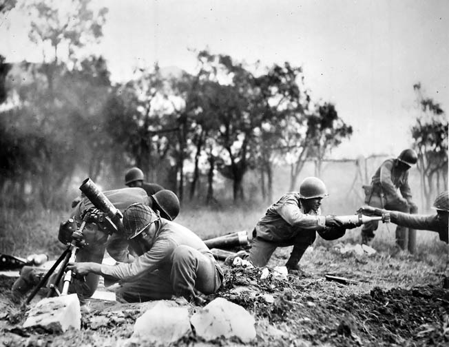 Men of the African American 92nd Infantry Division fire mortars near Massa, November 1944.