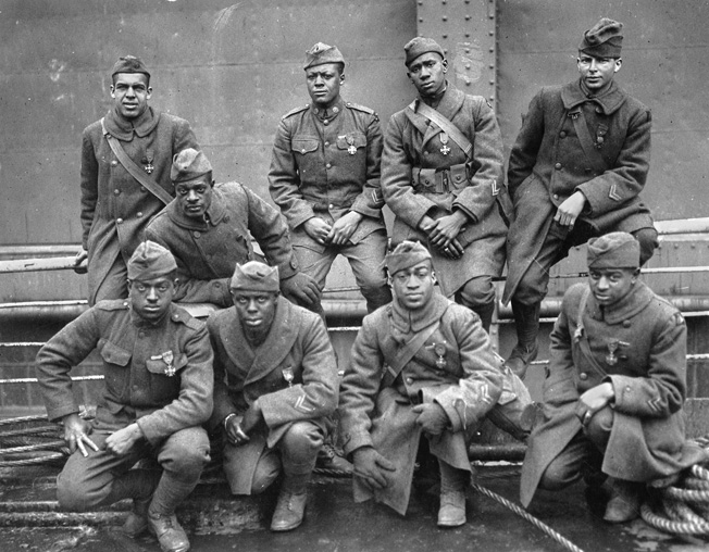 Group portrait of bravery. African American soldiers of the 369th Regiment (a New York element attached to the French Army) who were awarded the Croix de Guerre for gallantry in action in France in World War I. (L. to R., front row): Ed Williams, Herbert Taylor, Leon Fraitor, Ralph Hawkins. (Back row): H.D. Prinas, Dan Stroms, Joe Williams, Alfred Hanley, T.W. Taylor.