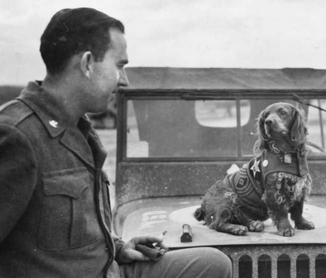 """Below, First Sergeant """"Curly"""" is about to lose his 2nd Infantry Division patch, as he was transferred to the 75th Infantry Division at Camp Atlanta, near Chalons, France. Dangling from his neck are his dog tags—or as he called them, """"me tags."""""""