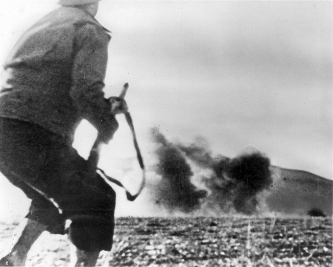 A German artillery shell shocks an American soldier on the battlefield in North Africa. Early encounters with the Germans resulted in stinging defeats for the U.S. Army.