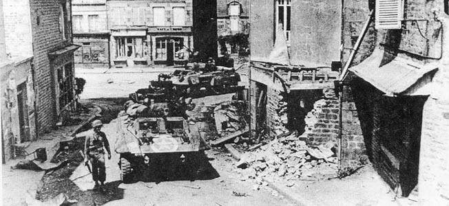American Sherman tanks battle German Panthers blocking a minor intersection in St. Sever after the Normandy invasion.