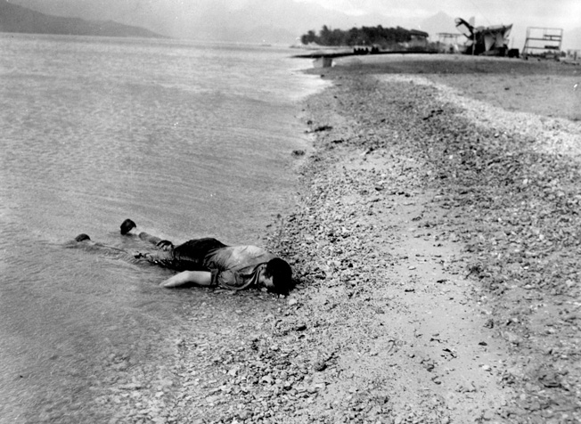 A fallen sailor on the beach at Kaneohe Bay.