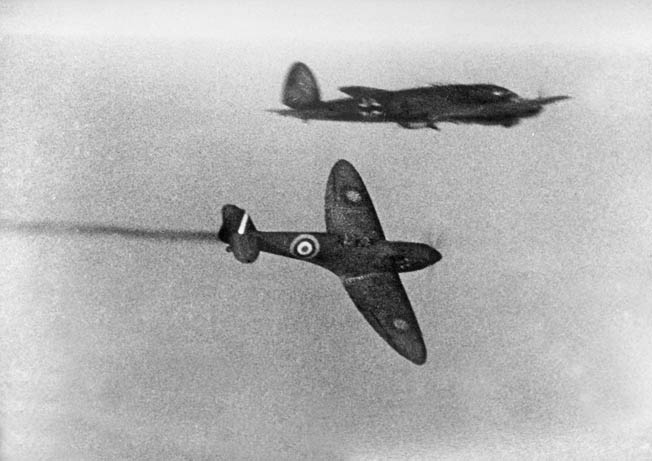 A British Spitfire attacks a German He-111 during the Battle of Britain. On August 25, 1940, an He-111 crew overshot its target and bombed London in the darkness, unleashing British reprisal attacks on Berlin.
