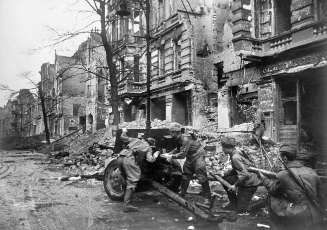 A Red Army gun crew loads their antitank cannon in a Berlin street during the fighting for the city.