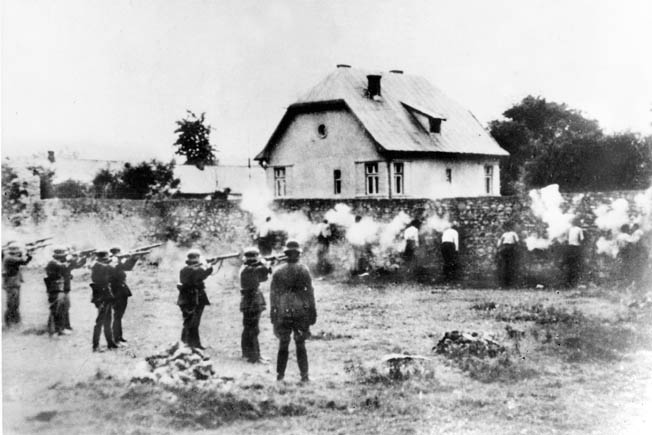 "Theodor Eicke's SS-VT ""Death's Head"" units were responsible for committing numerous atrocities, such as the murder of Polish Jews and intellectuals. Here a firing squad executes civilians, autumn 1939."