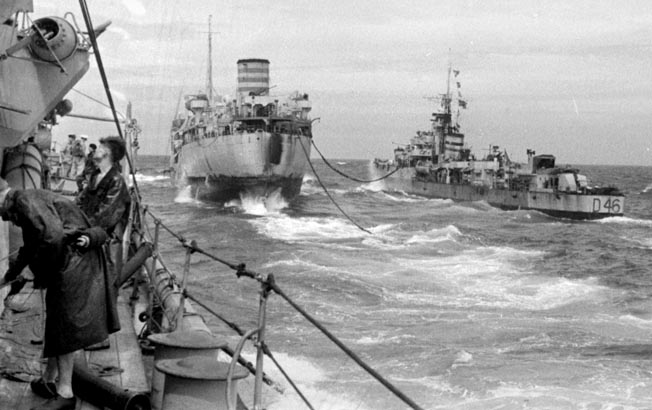 An auxiliary ship of Task Force 57 (center) refuels a British destroyer at sea. The Royal Navy struggled with logistics and resupply over the vast distances of the Pacific.
