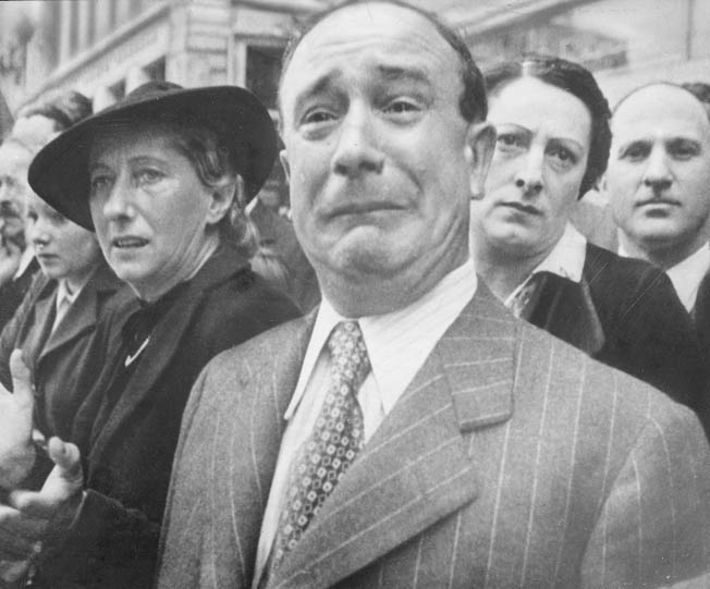 French civilians, some applauding, some crying, watch as their troops leave for French colonies in Africa, while their country is taken over by the Germans. From the U.S. propaganda film, Divide and Conquer.