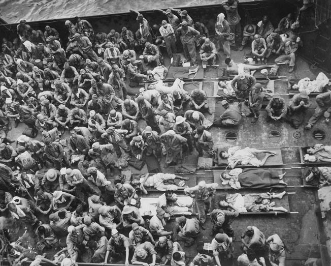 Although many Japanese soldiers chose suicide rather than surrender, 221 of those enemy soldiers taken prisoner are shown on the deck of an American transport vessel, headed for a prisoner of war camp in Hawaii. Japanese holdouts were captured on Guam as late as the 1970s.