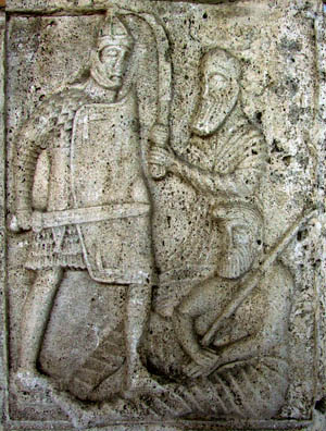 A Roman on the Tropaeum Traiani stabs while using his scutum to protect his body. The sword's blade was double edged for cutting and had a tapered point for stabbing during thrusting.