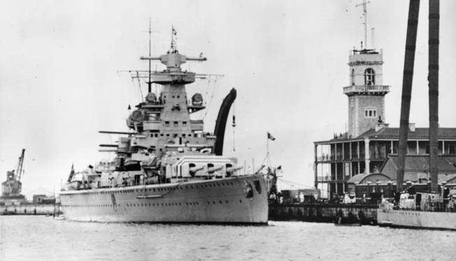 The Admiral Scheer, photographed in port at Gibraltar in 1936 during the Spanish Civil War. The German heavy cruiser was the most successful and feared surface raider of the war.