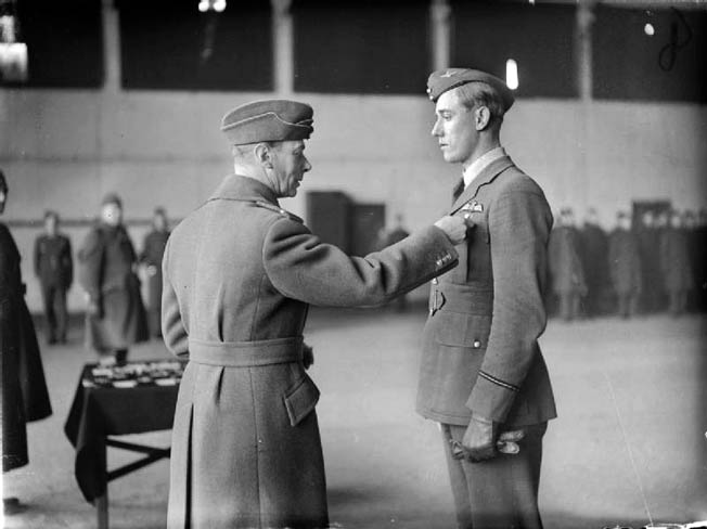 "England's King George VI confers a bar to the Distinguished Flying Cross to Hurricane Pilot Albert Gerald ""Zulu"" Lewis for shooting down five enemy aircraft in one day in September 1940."
