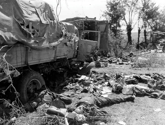 Dead German soldiers and destroyed trucks and armored vehicles litter the countryside of northern France after an air attack by Allied fighter bombers near the towns of Falaise and Argentan. General Montgomery was instrumental in issuing an ill-conceived order for American troops to halt before much of the German Seventh Army was encircled in the Falaise Pocket. As a result, approximately 200,000 Germans escaped the trap to fight another day.