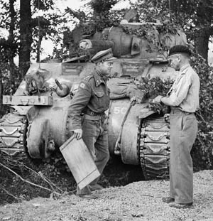 """British 11th Armoured Division commander Maj. Gen. G.P.B. """"Pip"""" Roberts (left) with Brigadier Roscoe Harvey, 29th Armoured Brigade commander, confer in front of Harvey's command tank during the British advance through Belgium, September 1944."""
