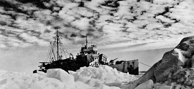 The Coast Guard cutter USS Northland lies at anchor in the Arctic. Northland landed a 12-man shore party that surprised three Germans setting up radio equipment on Greenland.