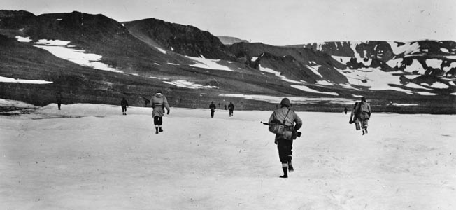 Following the discovery of a German radio and weather station on Greenland, American soldiers move out in November 1943 to eliminate the enemy presence. Greenland, a Danish possession, was also frequented by free Danish hunters, and the Germans' secret camp had been located by a hunting party days earlier.