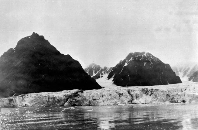The bulk of a large glacier extends from the shore of Spitsbergen Island, a Norwegian possession. Norwegian ski troops made an abortive attempt to drive the Germans from the island; however, by the time they reached a German base camp on Spitsbergen, the enemy had largely evacuated.