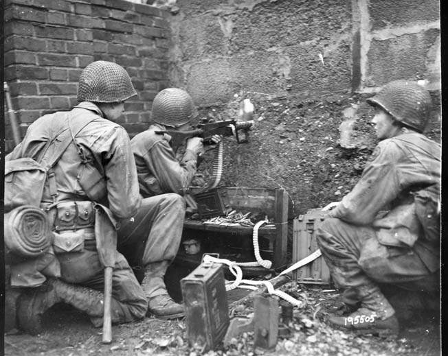 U.S. infantryman fires a .50-caliber machine gun at Germans on a rural French farm. The tenacious resistance of the U.S. infantry stunned panzer troops, who believed they could easily overrun U.S. infantry lacking close armor support.