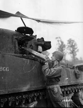 An assistant gunner replenishes tank shells. The 4th Armored Division proved equal to the task of taking on newly created German panzer regiments with PzKpfw V Panther medium tanks.