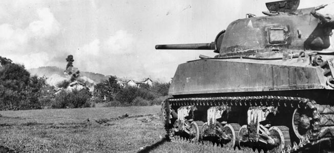 An M4 Sherman medium tank belonging to the U.S. Third Army fires on German positions near the city of Nancy, France, in the summer of 1944. The Sherman did not pack the firepower of opposing German tanks; however, it appeared on the battlefields of Western Europe in overwhelming numbers.