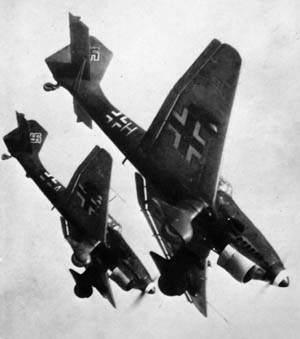 Stuka aircraft dive bombed Allied troop concentrations in support of the German armored columns.