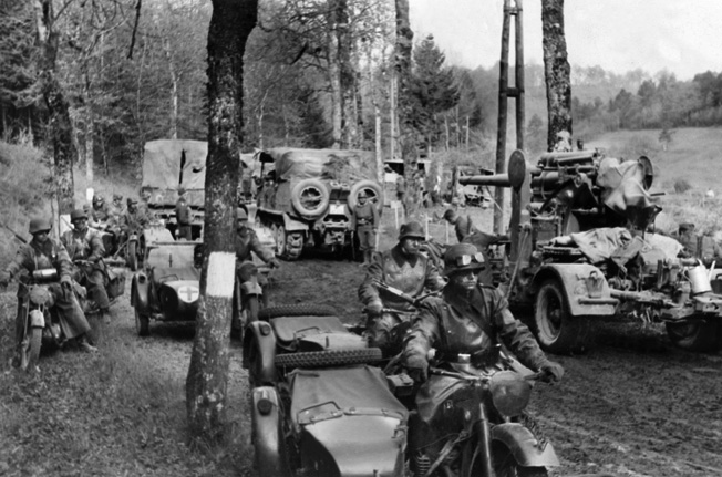 A German motorized column moves through the Ardennes. By mid-May, the British were surrounded on three sides and in danger of being cut off from their fuel supplies.