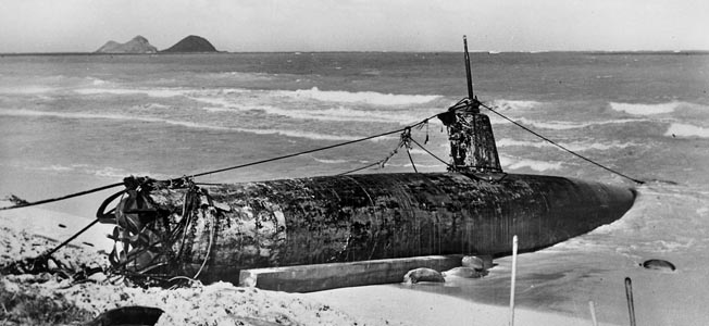 One of the midget submarines that attacked Pearl Harbor on December 7, 1941, ran aground and was later dragged onto a beach on Oahu. The debate concerning the success or failure of the submarine attacks that Sunday morning remains a source of some controversy. The first Japanese prisoner of war taken by Americans during World War II was the commander of one of these small craft.
