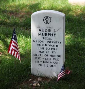 Audie Murphy has a government-issue headstone no different from those of thousands around him, except that Murphy's lists more awards.