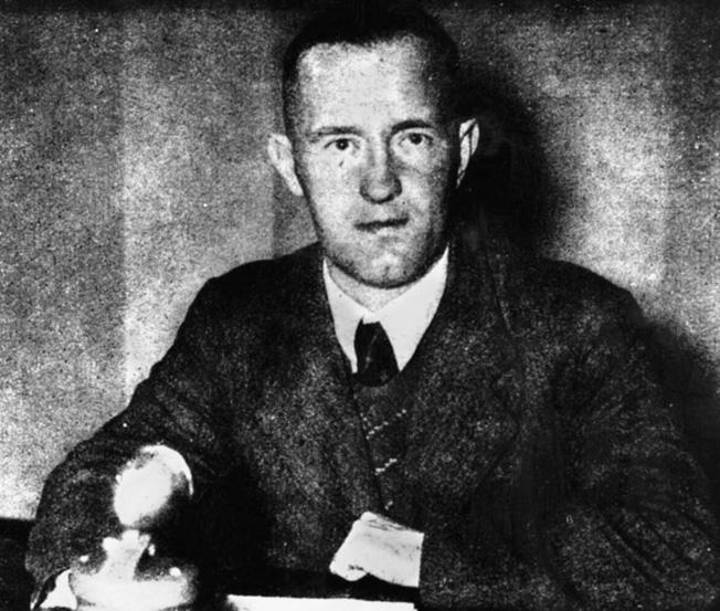 "Fascist William Joyce, ""Lord Haw Haw,"" in a German radio studio."