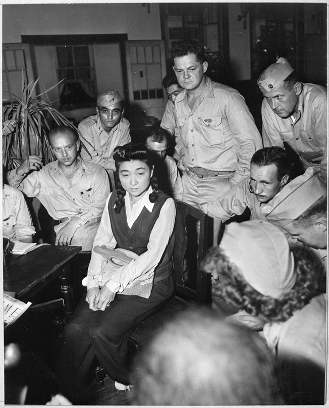Military reporters interview Iva Toguri, an American citizen who made radio broadcasts for Japan, September 1945.