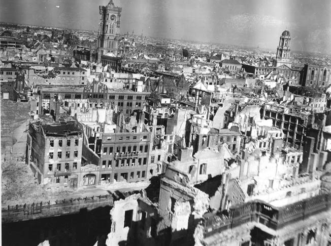 A low-level aerial view of Berlin taken four months after the war gives an idea of the total devastation. The building with the tower (left) is the Rotes Rathaus (Red City Hall).