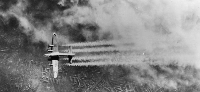 With smoke from explosions and fires blanketing Berlin below, a B-17's four 1,900 hp engines leave contrails in the cold air, February 3, 1945.