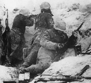 German soldiers positioned in a foxhole during the Ardennes offensive.