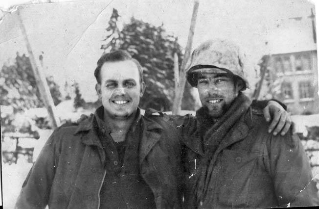 Pfc. Ralph Puhalovich (right) with a buddy in Bullingen, Belgium, January 1945—about the time he earned the Bronze Star Medal for valor.