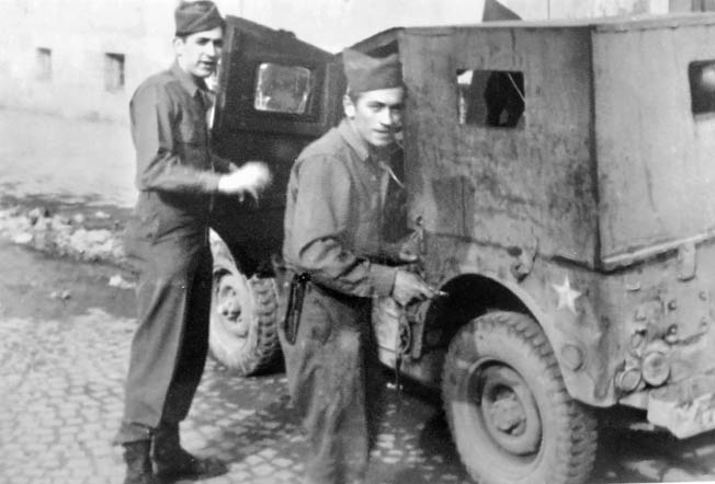 Leon Tulper (left) stands with his driver outside their radio jeep somewhere in Germany.