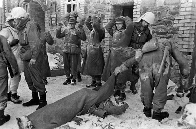 Soldiers of the 99th Infantry Division search German prisoners during the Battle of the Bulge. As word of German atrocities spread, American soldiers took fewer prisoners during the desperate fighting. The three drunk Germans that Sergeant Walter's men captured may not have reached a prison camp.