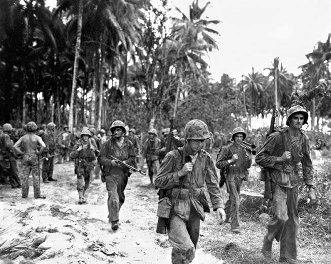 Weary members of the 1st Battalion, 3rd Marines return from the jungle. They were the first to hit the beach at Cape Torokina, where the strongest Japanese opposition was encountered.