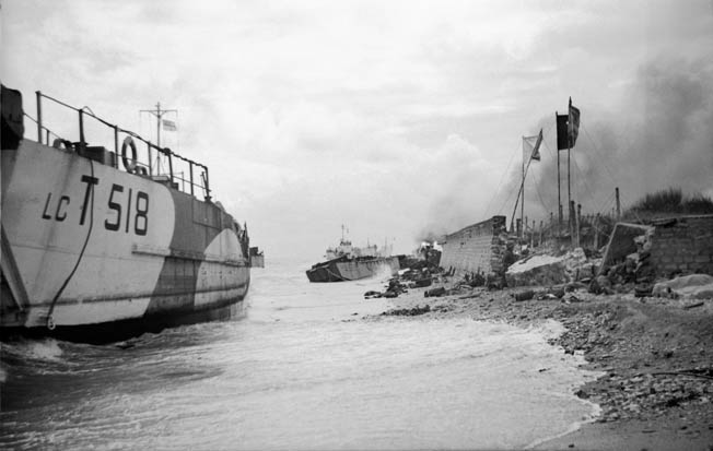 Making the initial landing at Nan Red Beach, on the left flank of Juno Beach, Canadian infantry disembark from their landing craft under German fire shortly after 8 am on D-Day.